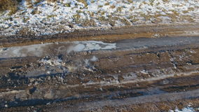 Gravel country road in winter time. Aerial view stock video footage