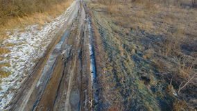 Gravel country road in winter time. Aerial view stock footage