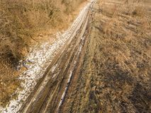 Gravel country road in winter time. Royalty Free Stock Photography