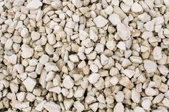 Gravel or crushed stone in natural light texture stock photography