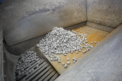 Gravel in crushing machine Stock Photos