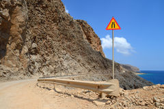 Gravel dangerous road in Greece Royalty Free Stock Photos