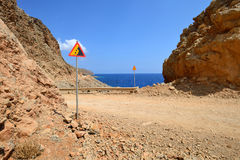 Gravel dangerous road in Greece Stock Photos