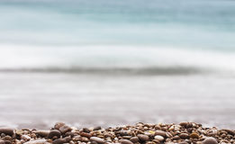 Gravel Depth Of Field and sea background Royalty Free Stock Photography