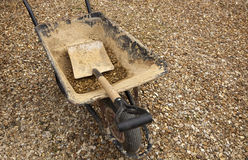 Gravel Driveway. Wheelbarrow and shovel on a gravel driveway Stock Images