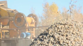Gravel enterprise is working sorting stones. Industrial equipment is in process of loading, splitting up and distributing getting ready for transportation to stock footage