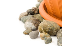 Gravel with flowerpot Stock Photos