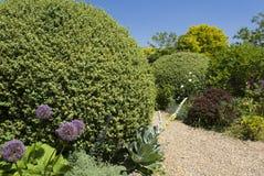 Gravel garden path. English garden Royalty Free Stock Photo