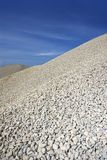 Gravel gray mound quarry stock blue sky Royalty Free Stock Photos