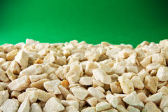 Gravel on green Stock Photos