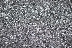 Gravel on the ground usable for background. Grey red colors. royalty free stock photo