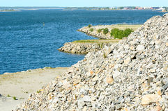 Gravel hill in nature. Large gravel hill close to coastline with archipelago in background Stock Images