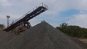 Gravel mountain .Conveyer for a macadam Stock Photography