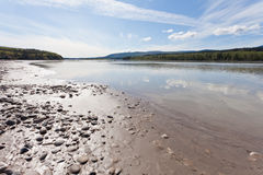 Gravel and mud at Yukon River near Dawson City Stock Image