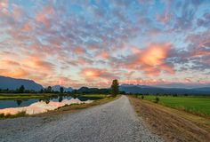 Gravel Path with Amazing Clouds Stock Photo