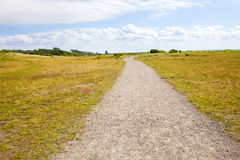 Gravel path in countryside. Gravel path in beautiful countryside with fields and sky Stock Photography
