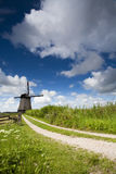 Gravel path to a Dutch Windmill Royalty Free Stock Images