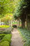 Gravel Pathway Leading to Gazebo in Garden. A path made of gravel in a peaceful garden, leading to a gazebo Stock Photo