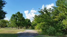 Gravel Pathway. In park under blue skies royalty free stock photo