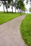 Gravel pathway in summer park. Gravel pathway in summer time park Stock Photos