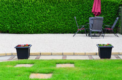 Gravel patio area in the garden Royalty Free Stock Image
