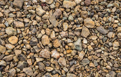 Gravel. Patterned cobbled Beach front surface of the lake Stock Photo