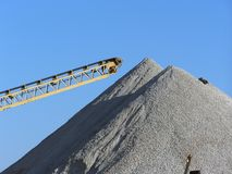 Gravel pile. Large gravel pile with conveyor Stock Photos