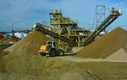 Gravel being moved by bulldozer Royalty Free Stock Images