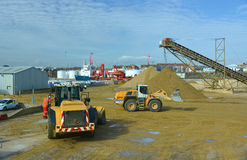 Gravel being moved by heavy vehicles Stock Photos