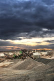 Gravel piles at mining factory with cloudscape Royalty Free Stock Photography