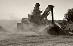 Gravel pit. Dust from conveyor belt in gravel pitgravel pit Royalty Free Stock Images