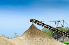 Gravel pit. Blue sky industry background Royalty Free Stock Image