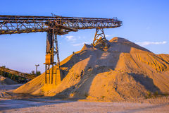 Gravel pit. With an industrial gravel sorter machinery and clear blue sky Stock Images