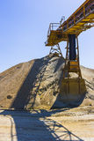 Gravel pit. With an industrial gravel sorter machinery and clear blue sky Royalty Free Stock Images