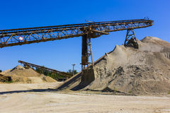 Gravel pit. With an industrial gravel sorter machinery and clear blue sky Stock Image