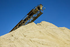 Gravel pit. With an industrial gravel sorter machinery and clear blue sky royalty free stock photos