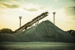 Gravel pit. With an industrial gravel sorter machinery at sunset Royalty Free Stock Photo