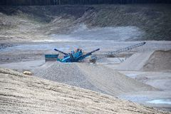 Gravel Pit machines and trucks Royalty Free Stock Photography