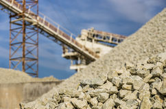 Gravel Quarry. Detail of a gravel quarry with defocused machines in the background Royalty Free Stock Image