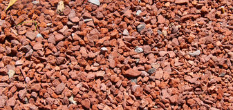 Gravel. Red and pink small gravel stones, little stones used as floor in different scales of reds, texture background royalty free stock image