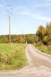 Gravel road. Rural road and power lines Stock Photography