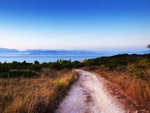 Gravel road. View of the road gravel on the coast Stock Photography