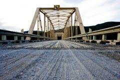 Gravel road. That crosses a bridge Royalty Free Stock Images