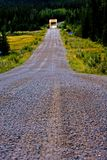 Gravel road. Photo of a gravel road that leads to a yellow bridge Stock Photo
