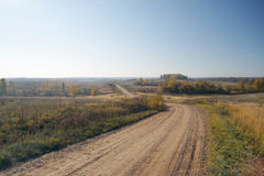 Gravel road in autumn Royalty Free Stock Photos