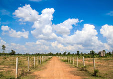 Gravel road and blue sky Stock Photos