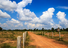 Gravel road and blue sky Royalty Free Stock Photo