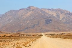 Gravel road Brandberg highest mountain, Damaraland, Namibia Stock Photo