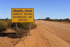 Gravel Road Careful Driving Sign Stock Image