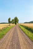 Gravel road in countryside Stock Photos